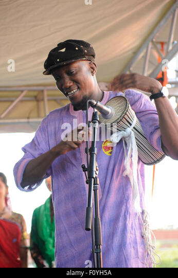 Senegalese percussionist, Mamadou Tama, playing with the Ensemble Surabhi group. African Senegal music being played. - Stock Image
