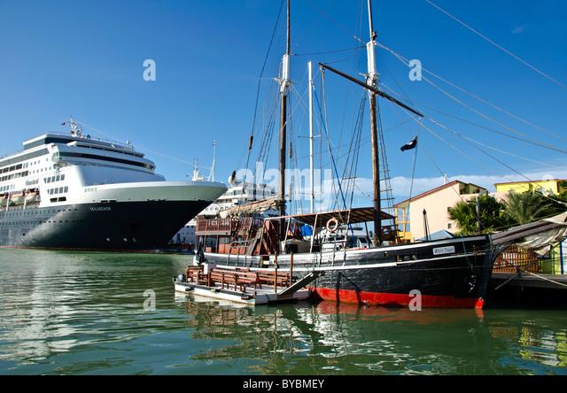 Antigua St Johns Maasdam caribbean cruise ship dock, sailing schooner at Redcliffe Quay - Stock Image
