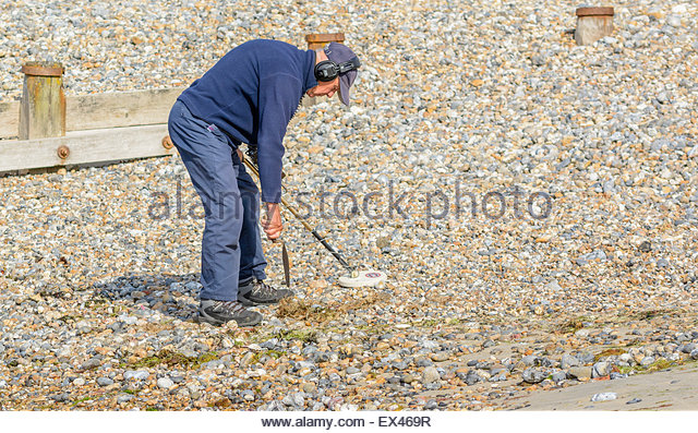 Jew Detector: Metal Detectorist Beach Stock Photos & Metal Detectorist