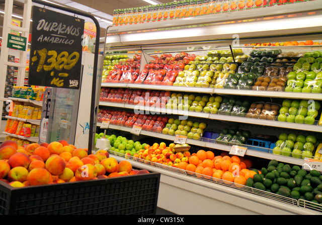 Mendoza Argentina Villa Nueva Mendoza Plaza Shopping grocery store supermarket business shopping shelf shelves package - Stock Image