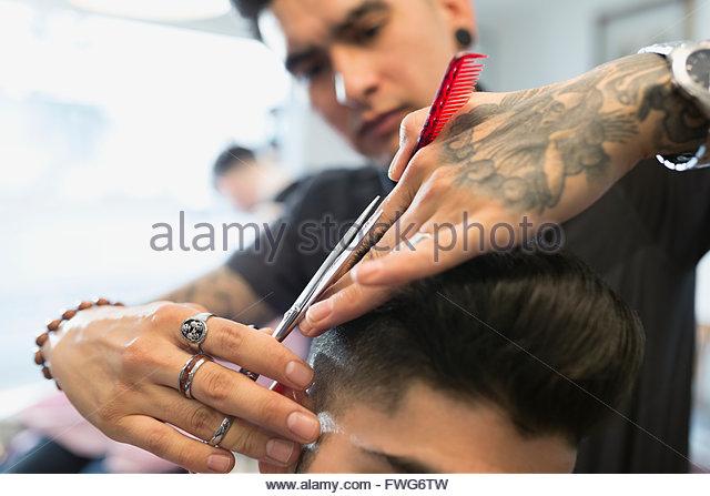 Close up barber cutting man - Stock Image
