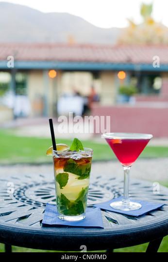 Cocktail al fresco during twilight outside a restaurant. - Stock Image