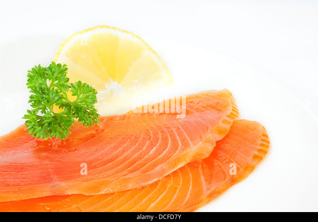 Smoked Salmon - cold smoked salmon on a plate with parsley and lemon. - Stock Image