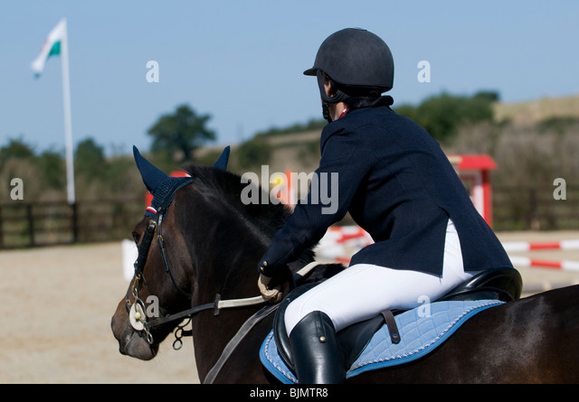 Horse rider looking at the show jumping course - Stock Image