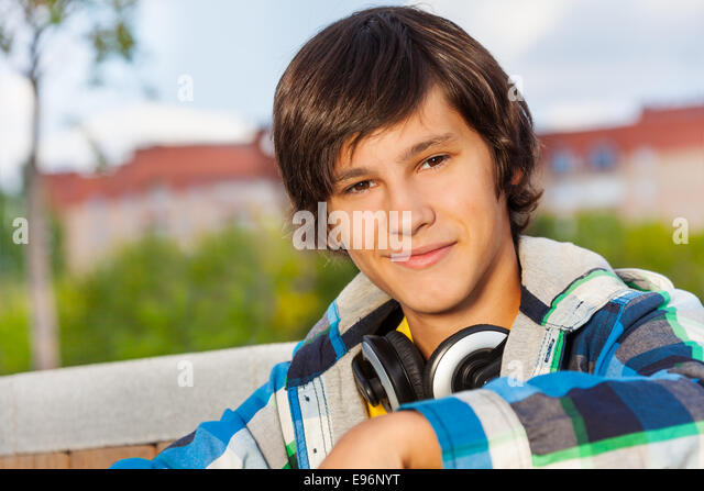 Close up view of boy wearing headphones - Stock Image