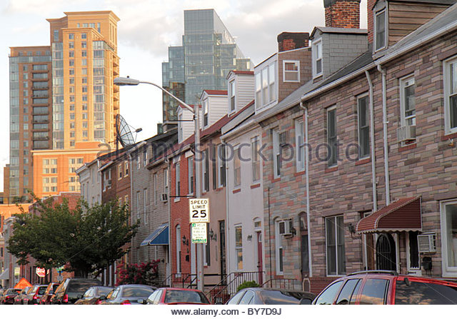 Baltimore Maryland Little Italy ethnic neighborhood row house brick Formstone contrast high-rise traffic sign speed - Stock Image