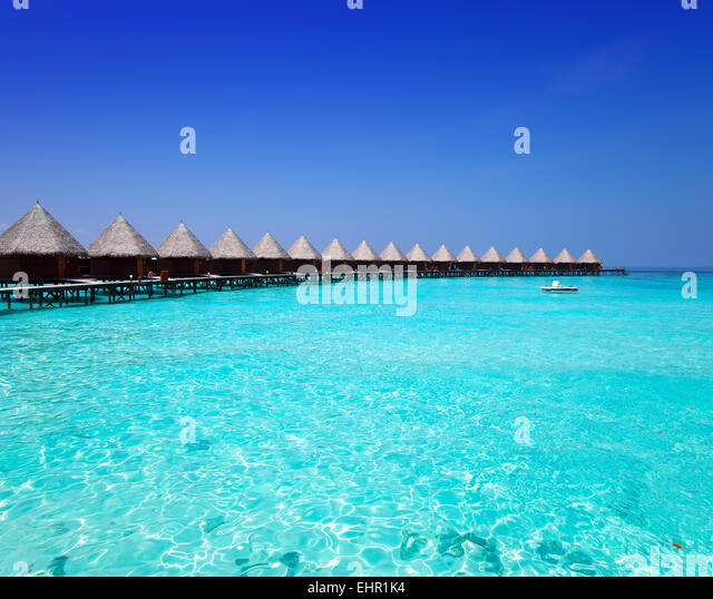 houses on piles on sea. Maldives - Stock-Bilder