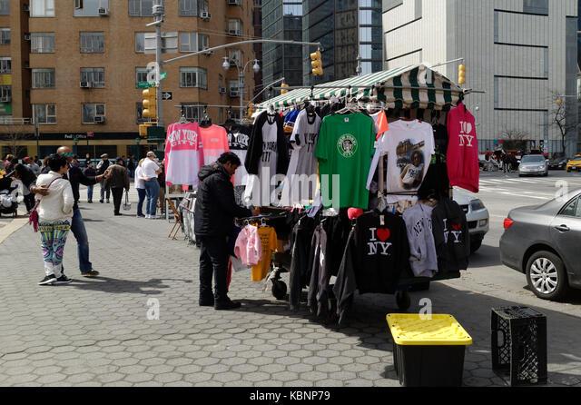 New York City vendor selling tourist merchandise at Columbus Circle in midtown Manhattan. - Stock Image