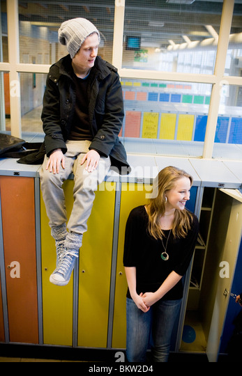 Guy and girl by the lockers - Stock Image