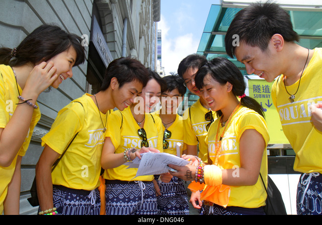 Hong Kong China Kowloon Tsim Sha Tsui Nathan Road Asian student man woman PSquare preparing survey questionnaire - Stock Image