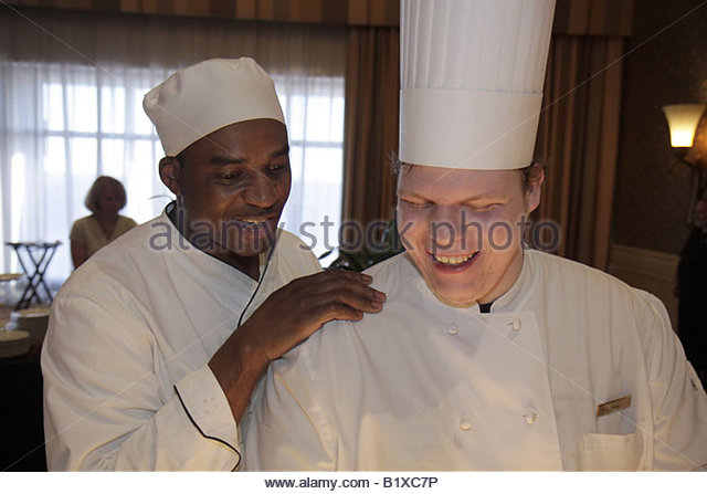 Little Rock Arkansas The Peabody Little Rock hotel reception dinner cook chef Black man men work white uniform toque - Stock Image