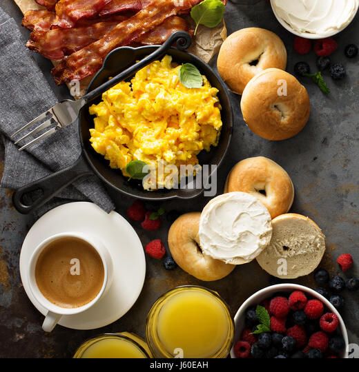 Big breakfast with bacon and scrambled eggs - Stock Image