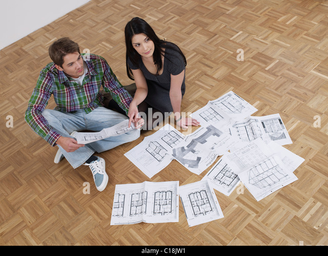 Couple plans flat renovations - Stock Image