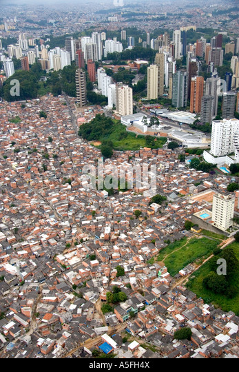 Aerial view of crowded favela housing contrasts with modern apartment buildings in Sao Paulo Brazil - Stock Image