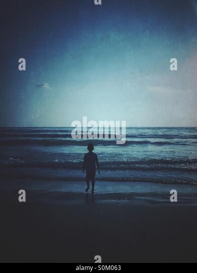Little boy by the sea - Stock Image