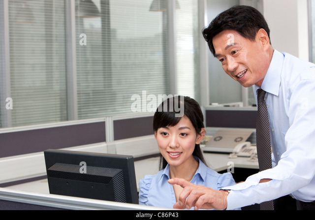 Colleague Helping Co-Worker - Stock Image