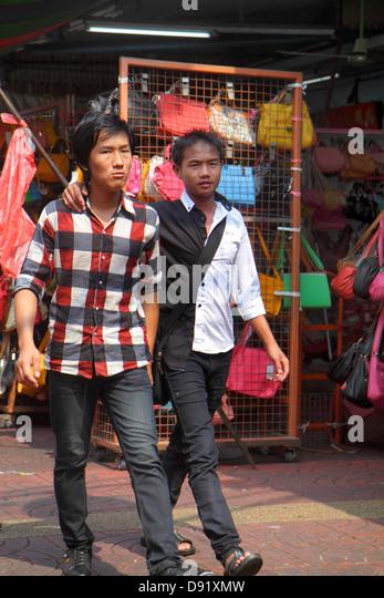 Bangkok Thailand Samphanthawong Chinatown Mangkon shopping market marketplace Asian man friend arm around shoulder - Stock Image
