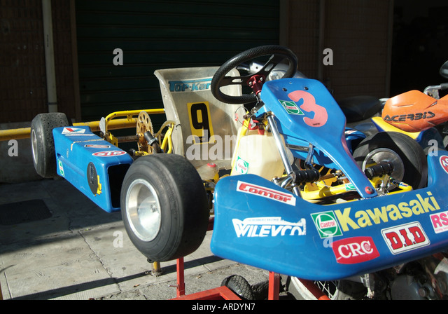 go kart racing car on its maintenance stand in the pits - Stock Image