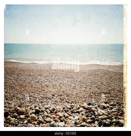 Shingle beach on a quiet day - Stock Image