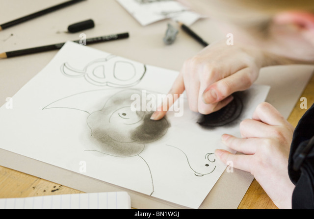Artist drawing with charcoal - Stock Image