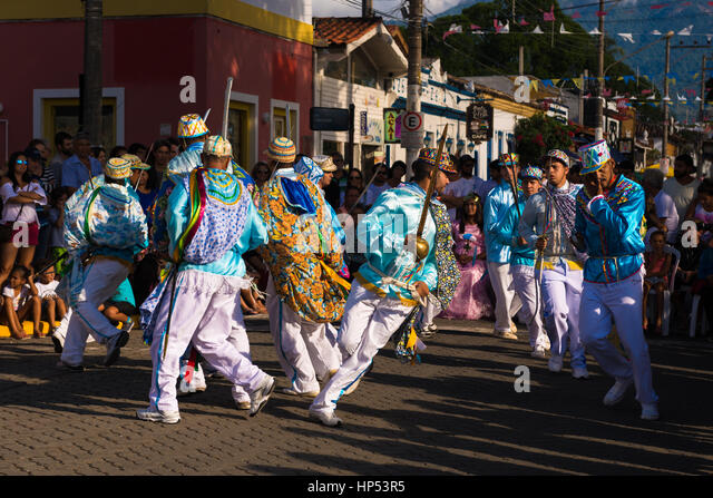 Performers at the Congada festivity in Ilhabela, SE Brazil - Stock Image