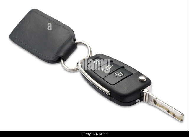 a car key and fob with shallow depth of field on white with clipping path - Stock Image