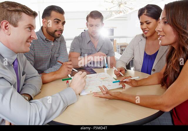 Small group of people having brainstorming business meeting - Stock Image