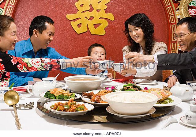 Asian family dinner smiling stock photos asian family for Japanese eating table