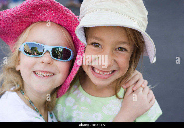 Two young girls, portrait - Stock-Bilder