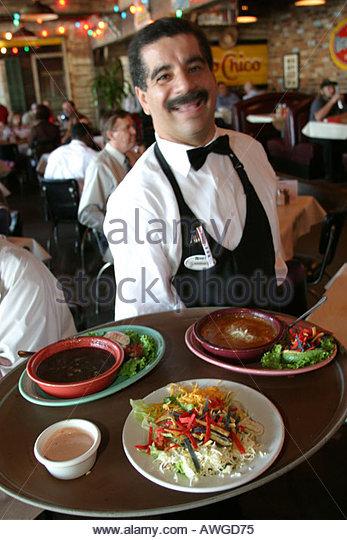 Huntsville Alabama Rosie's Mexican Cantina dining eating Hispanic male waiter - Stock Image