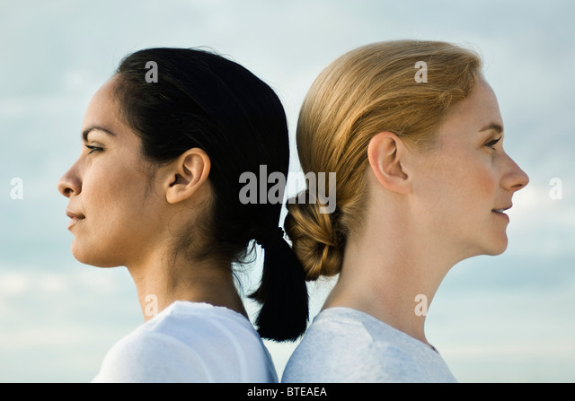 Women back to back, portrait - Stock Image