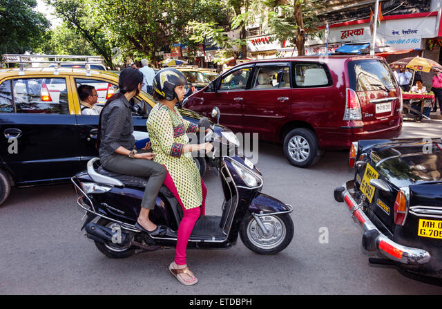 Mumbai India Indian Asian Fort Mumbai Kala Ghoda Veer Nariman Road traffic woman motor scooter - Stock Image