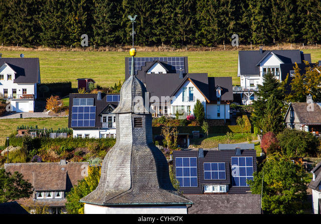 Solar panels on a roof of private houses. Solar thermal energy. - Stock Image