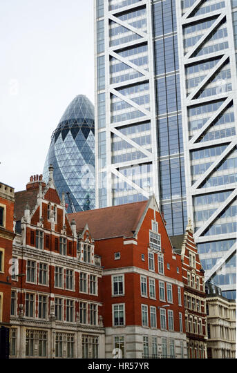 Contrasting architecture as seen from Liverpool street in London, UK, with the Heron Tower and the Gherkin in the - Stock Image