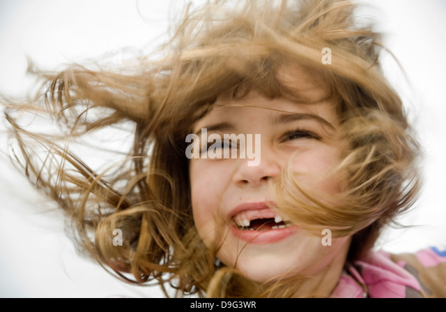 VICTORIA, B.C. – SEPTEMBER 2: Girl with hair blowing in the wind in Victoria British Columbia, Canada on September - Stock Image