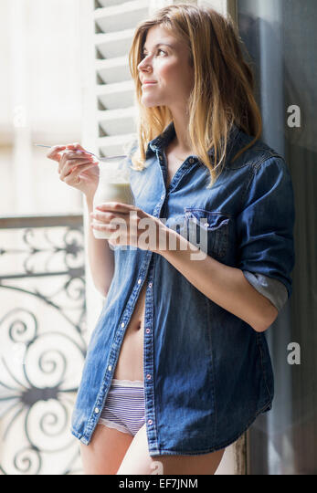 Happy woman drinking milk - Stock Image