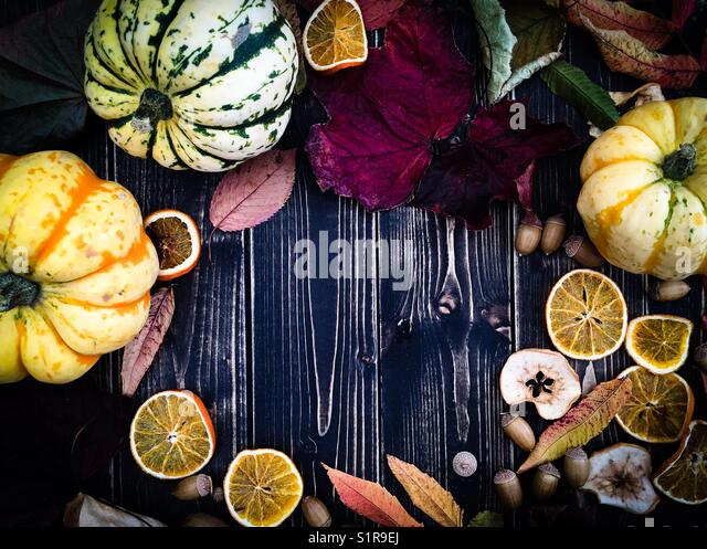 Autumnal Composition on Black Wooden Background - Stock Image