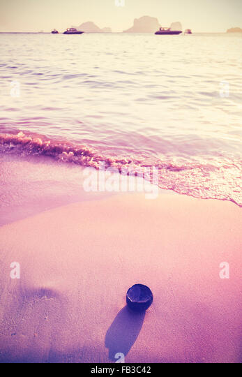 Vintage toned photo of a beach, holidays background. - Stock-Bilder