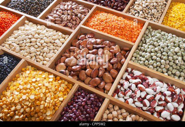 peas, beans and lentils in the wooden box - Stock Image