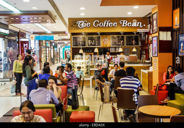 Mumbai India Asian Lower Parel High Street Phoenix mall inside The Coffee Bean cafe tables customers - Stock Image