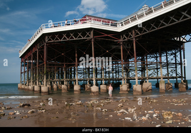 Cromer pier with the tide out Cromer Norfolk East Anglia England UK - Stock Image