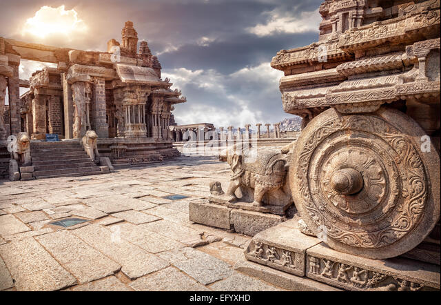 Stone chariot in courtyard of Vittala Temple at sunset overcast sky in Hampi, Karnataka, India - Stock Image