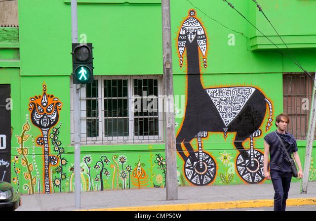 Chile Santiago Barrio Patronato Avenida Santa Maria immigrant neighborhood mural street art artist Juanita Perez - Stock Image
