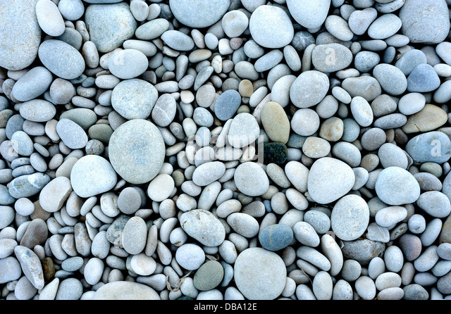 PEBBLES OR SMALL STONES ON A BEACH - Stock Image