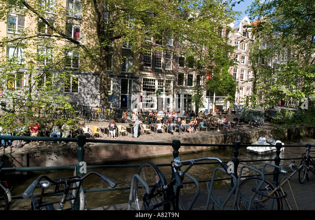 Amsterdam Jourdan street cafe at a canal typical architecture bicycles - Stock Image