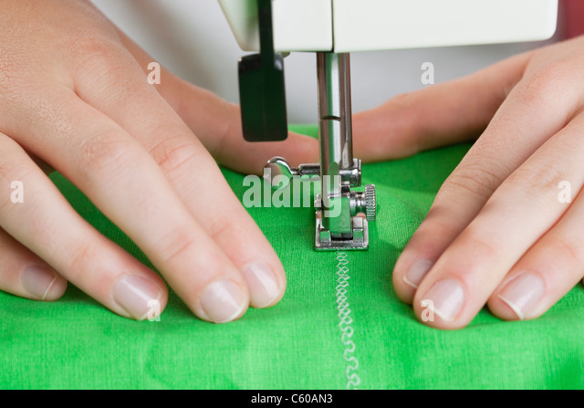 USA, Illinois, Metamora, close-up of woman sewing - Stock Image
