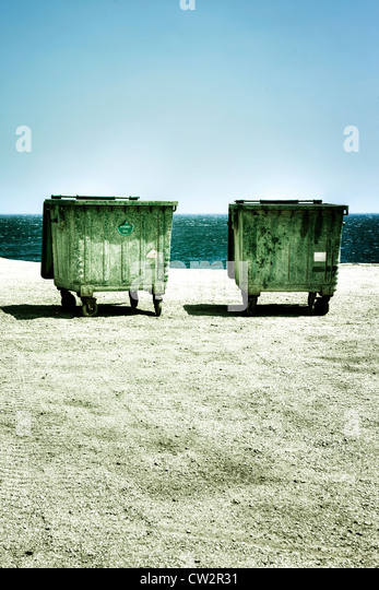 two dumpsters at the sea shore - Stock Image