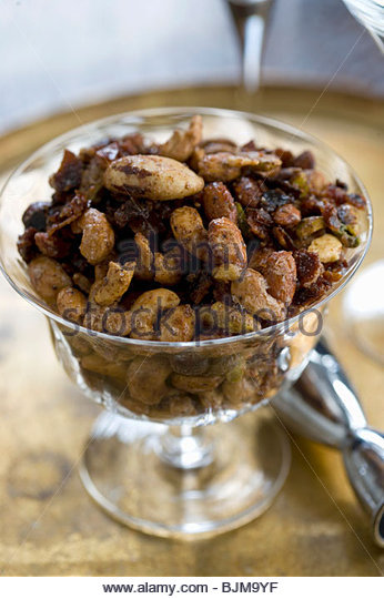 Glass Bowl of Mixed Nuts - Stock Image