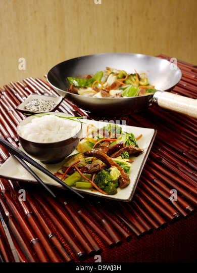 stir fry broccoli and white rice - Stock Image