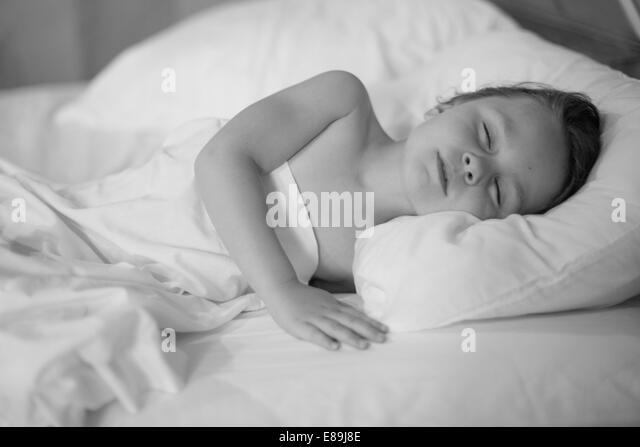 Girl napping in bed - Stock-Bilder
